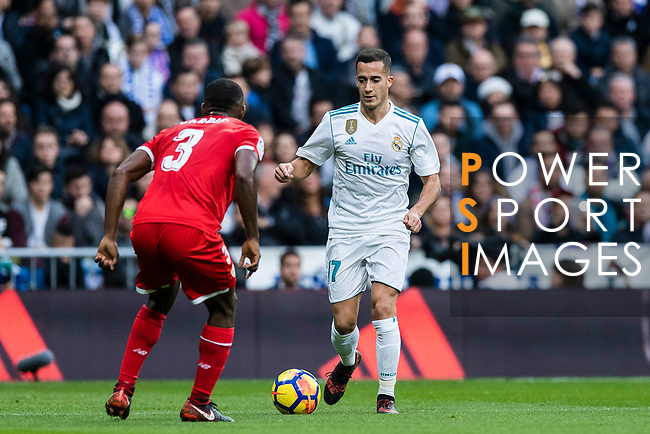 Lucas Vazquez (r) of Real Madrid is tackled by Lionel Jules Carole of Sevilla FC during the La Liga 2017-18 match between Real Madrid and Sevilla FC at Santiago Bernabeu Stadium on 09 December 2017 in Madrid, Spain. Photo by Diego Souto / Power Sport Images