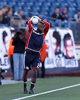 New England Revolution defender Andrew Farrell (2) throw in. .  In a Major League Soccer (MLS) match, FC Dallas (red) defeated the New England Revolution (blue), 1-0, at Gillette Stadium on March 30, 2013.