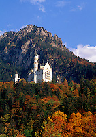 Scenic view of Neuschwanstein Castle and surrounding alpine landscape in autumn. Germany.