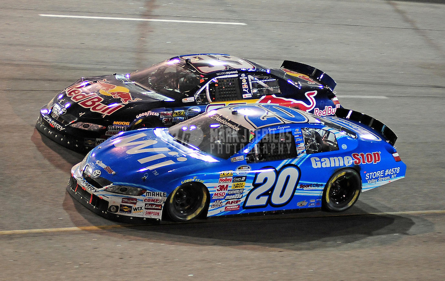 May 1, 2009; Richmond, VA, USA; NASCAR Nationwide Series driver Joey Logano (20) races alongside Scott Speed (99) during the Lipton Tea 250 at the Richmond International Raceway. Mandatory Credit: Mark J. Rebilas-