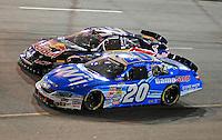 May 1, 2009; Richmond, VA, USA; NASCAR Nationwide Series driver Joey Logano (20) races alongside Scott Speed (99) during the Lipton Tea 250 at the Richmond International Raceway. Mandatory Credit: Mark J. Rebilas-
