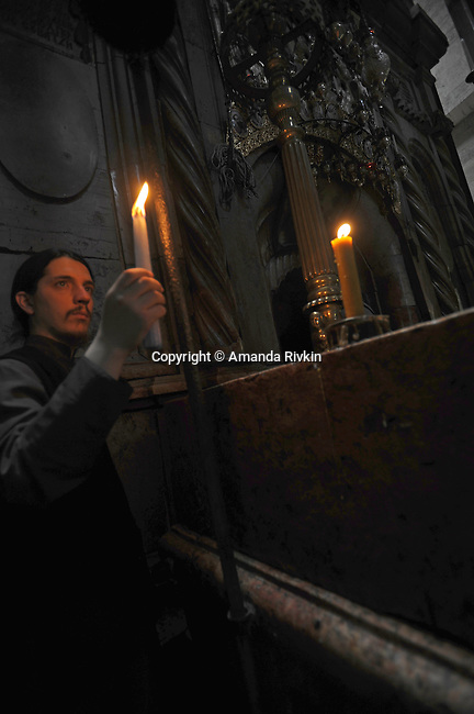 A visitor to the Church of the Holy Sepulcher in the old city of Jerusalem, Israel on June 6, 2008.