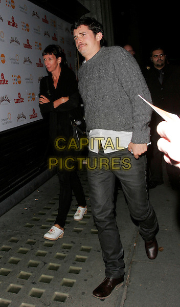 ORLANDO BLOOM.Leaving the Virgin Unite End Fistula Fundraising Evening, All Star Lanes, Bayswater, London, England..September 5th, 2007.full length grey gray trousers white shirt untucked jumper sweater funny face .CAP/AH.©Adam Houghton/Capital Pictures