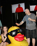 Big Brother contestant Adam Poch with rubber duckie and raffle winner at Big Brother 19 premiere on June 28, 2017 at Slate, New York City, New York. (Photo by Sue Coflin/Max Photos)