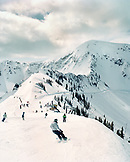 USA, Utah, skiing and snowboarding down to the Little Cloud Chairlift from the top of the tram, Snowbird Ski Resort