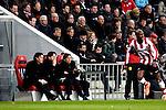 Nederland, Eindhoven, 31 maart 2012.Eredivisie.Seizoen 2011-2012.Phillip Cocu trainer-coach van PSV in overleg met zijn technische staf Ernest Faber en Chris van der Weerden