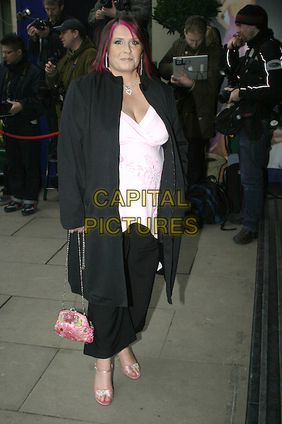LIZZY BARDSLEY.TRIC Awards - Television & Radio Industries Club at the Grosvenor House, Park Lane..March 8th, 2005.full length pink bag purse black jacket coat.www.capitalpictures.com.sales@capitalpictures.com.© Capital Pictures.