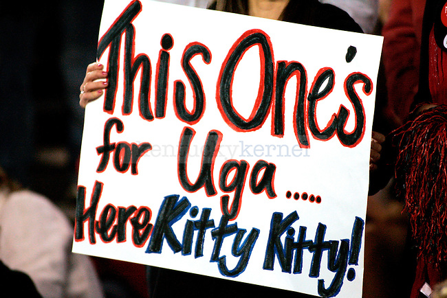 A Georgia fan holds up a sign in memory of Uga VII before the University of Kentucky Wildcats take on the University of Georgia bulldogs on Saturday, Nov. 21, 2009 at Sanford Stadium in Athens, Ga.