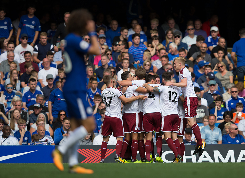 Burnley players celebrate their sides third goal <br /> <br /> Photographer Craig Mercer/CameraSport<br /> <br /> The Premier League - Chelsea v Burnley - Saturday August 12th 2017 - Stamford Bridge - London<br /> <br /> World Copyright &copy; 2017 CameraSport. All rights reserved. 43 Linden Ave. Countesthorpe. Leicester. England. LE8 5PG - Tel: +44 (0) 116 277 4147 - admin@camerasport.com - www.camerasport.com