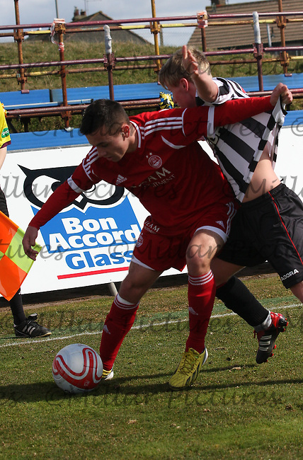 Stephen O'Neill  shields the ball but fouls Jon Scullion in the Aberdeen v St Mirren Clydesdale Bank Scottish Premier League Under 20 match played at Balmoor Stadium, Peterhead on 19.4.13.