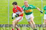 A strong challenge from Aidan Moynihan of Mitchels, but Dingle's Damien Ryan hangs on to the ball.   Copyright Kerry's Eye 2008
