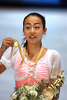 November 19, 2005; Paris, France; Figure skating star MAO ASADA of Japan celebrates gold medal win in ladies figure skating at Trophee Eric Bompard, ISU Paris Grand Prix competition.  Asada is just 15 years old and not eligible for the Torino 2006 Olympics, yet still a bright hope in Japanese figure skating for championships.<br />Mandatory Credit: Tom Theobald/<br /> Copyright 2005 Tom Theobald