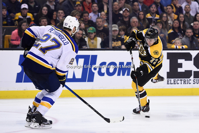 Tuesday, December 22, 2015: Boston Bruins center Frank Vatrano (72) shoots the puck past St. Louis Blues defenseman Alex Pietrangelo (27) during the National Hockey League game between the St. Louis Blues and the Boston Bruins held at TD Garden, in Boston, Massachusetts. The blues beat the Bruins 2-0 in regulation time. Eric Canha/CSM