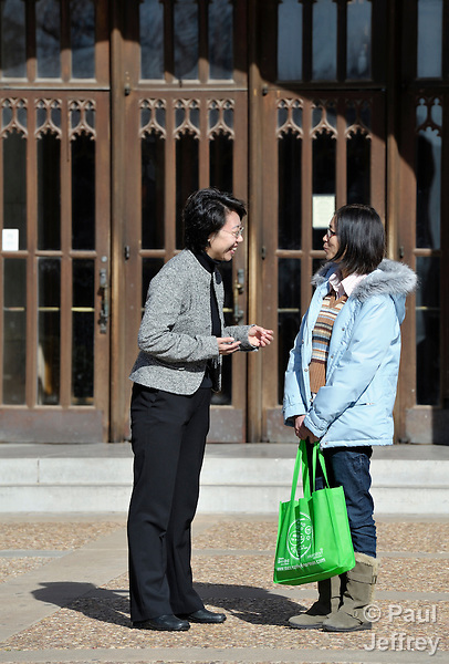 The Rev. Fuxia Wang (left) is a United Methodist missionary, serving as a church and community worker on the staff of the Wesley Center at the University of Oklahoma in Norman, where she works with international students. Here she talks with Yong Yao Zhoug, a Chinese student.