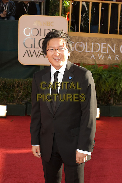 "MASI OKA.Nominated for Best Performance by an Actor in a Supporting Role for his work in ""Heroes,"" .Red Carpet Arrivals - 64th Annual Golden Globe Awards, Beverly Hills HIlton, Beverly Hills, California, USA..January 15th 2007.globes half length black suit .CAP/AW.Please use accompanying story.Supplied by Capital Pictures.© HFPA"" and ""64th Golden Globe Awards"""