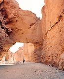 USA, California, woman hiking Natural Bridge Canyon hike, Death Valley National Park