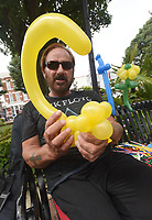 NWA Democrat-Gazette/FLIP PUTTHOFF <br /> MONKEYING AROUND<br /> Anthony &quot;The Bentonville Balloon Man&quot; Kellington forms a spider monkey out of a balloon on Friday Sept. 7 2018 during the First Friday event in downtown Bentonville. The downtown area becomes a community block party with a different theme on the first Friday of each month. Kellington has made balloon art at First Friday for two years. There's no charge for his creations but recipients may leave a tip.