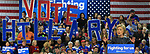 "Hillary Clinton supporters in the background hold up letters that spell out ""Vote Hillary"" during her speech at the carpenter's training center in Affton."