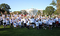 "Kids jump up in front of the White House during a  D.C United clinic in support of first lady Michelle Obama's ""Let's Move"" initiative on the White House lawn, in Washington D.C. on October 7 2010."