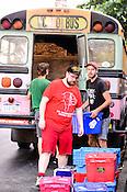 Dan Deacon unloads the Wham City Bus outside several Hopscotch Music Festival venues