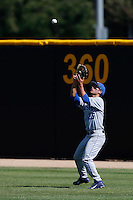 Luke Swenson #26 of the UC Santa Barbara Gauchos catches a fly ball during a game against the Cal State Northridge Matadors at Matador Field on May 10, 2013 in Northridge, California. UC Santa Barbara defeated Cal State Northridge, 6-1. (Larry Goren/Four Seam Images)