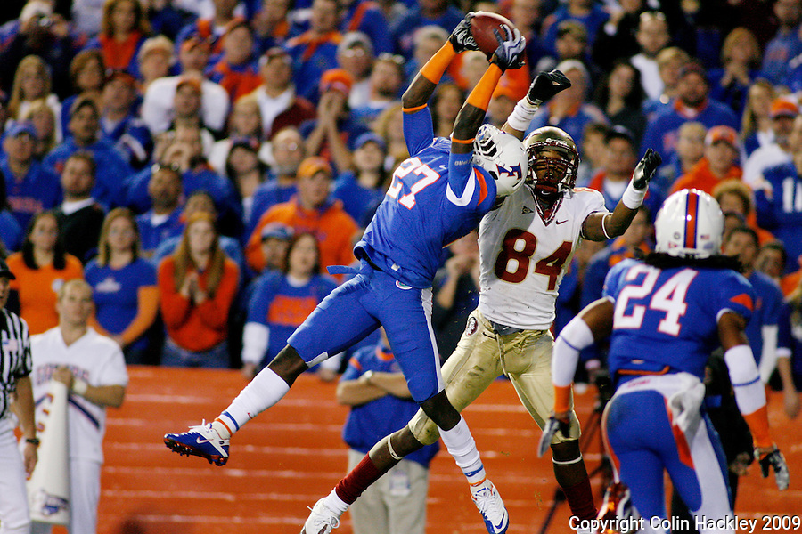 GAINESVILLE, FL 11/28/09-FSU-UF FB09 CH54-A pass intended for Florida State's Rodney Smith is intercepted by Florida's Adrian Bushell during second half action Saturday at Florida Field in Gainesville. The Gators beat the Seminoles 37-10..COLIN HACKLEY PHOTO