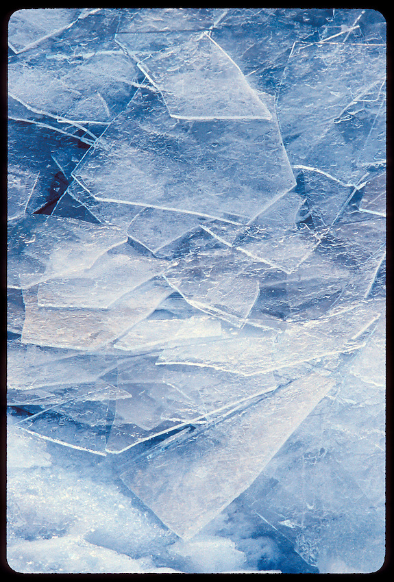 ICE SHARDS PILED ON A LAKE SUPERIOR SHORE IN MARQUETTE MICHIGAN.