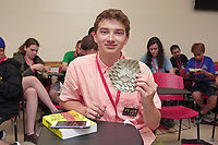 New York, NY, USA - June 24-25, 2017: OrigamiUSA 2017 Convention at St. John's University, Queens, New York, USA. Alessandro Beber, Italy, teaches a class how to fold his complex 1-Cube Tessellation. Nicholas Andrzejkiewicz, New York, completes the model.