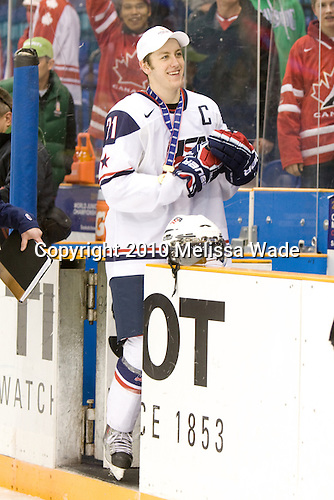 Derek Stepan (USA - 21) - Team USA celebrates after defeating Team Canada 6-5 (OT) to win the gold medal in the 2010 World Juniors tournament on Tuesday, January 5, 2010, at the Credit Union Centre in Saskatoon, Saskatchewan.