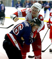 Mason Webster (no9) of Haringey drops his gloves and fights with Graham Bellamy of Slough during the National Ice Hockey League South Division 2 Cup - Group B game between Haringey Racers and Slough Jets at Alexandra Palace, London on Sat Sept 13, 2014.
