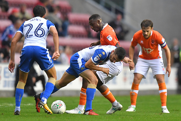 Blackpool's Viv Solomon-Otabor fights for the ball<br /> <br /> Photographer Dave Howarth/CameraSport<br /> <br /> The Carabao Cup - Wigan Athletic v Blackpool - Tuesday 8th August 2017 - DW Stadium - Wigan<br />  <br /> World Copyright &copy; 2017 CameraSport. All rights reserved. 43 Linden Ave. Countesthorpe. Leicester. England. LE8 5PG - Tel: +44 (0) 116 277 4147 - admin@camerasport.com - www.camerasport.com