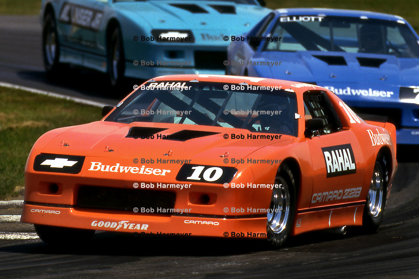 LEXINGTON, OH - JUNE 6: Bobby Rahal drives a Chevrolet Camaro Z28 ahead of Bill Elliott and Al Unser, Jr. on his way to victory in Round 2 of the IROC series on June 6, 1987, at the Mid-Ohio Sports Car Course near Lexington, Ohio.