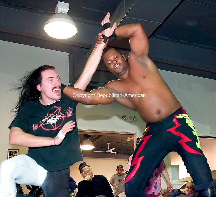 WATERBURY, CT. 22 January 2007--012207SV16--WWE RAW wrestlers Avil Graves and Slyk Wagner Brown wrestle during a show at Daybreak, an adult day care, in Waterbury Monday. Steven Valenti Republican-American