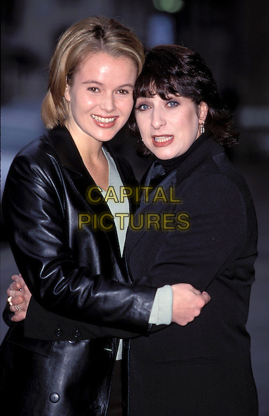 "AMANDA HOLDEN & CAROLINE QUENTIN.""Kiss Me Kate"" BBC Photocall.Ref: 7345.half length,  black leather, velvet, hugging, cuddling. smiling.sales@capitalpictures.com.www.capitalpictures.com.©Capital Pictures"