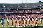 11 February 2006: Korea starting eleven face the Korean flag in the stadium (not pictured) during their national anthem, as Korean fans in the background fly the flag. The Costa Rica Men's National Team defeated South Korea 1-0 at McAfee Coliseum in Oakland, California in an International Friendly soccer match.