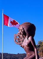 Ganges, Saltspring (Salt Spring) Island, Southern Gulf Islands, BC, British Columbia, Canada - Mermaid Sculpture holding Astrolabe and Canadian Flag in Rotary Marine Park (Artist Thomas Richard McPhee)