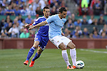 23 May 2013:  Karim Rekik (right)(NED) of Manchester City shields the ball from Cesar Azpilicueta (28)(ESP) of Chelsea.  Chelsea F.C. was defeated by Manchester City 3-4 at Busch Stadium in Saint Louis, Missouri, in a friendly exhibition soccer match.