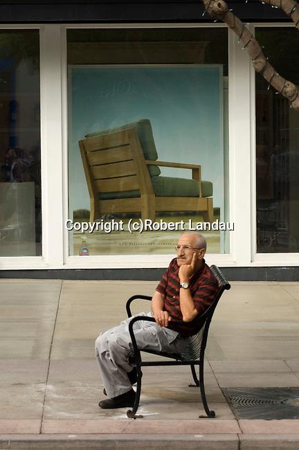 Man rsting on bench at 3rd St. Promenade, Santa Monica, CA