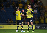 Dan Crowley of Oxford United congratulates Ryan Taylor of Oxford United on his goal during the The Checkatrade Trophy match between Oxford United and Exeter City at the Kassam Stadium, Oxford, England on 30 August 2016. Photo by Andy Rowland / PRiME Media Images.