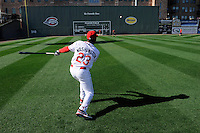 New hitting coach UL Washington (23) of the Greenville Drive hits balls off the left field wall to help his outfielders learn how to play balls off the wall during workouts during Media Day just prior to the start of the 2013 season on Tuesday, April 2, 2013, at Fluor Field at the West End in Greenville, South Carolina. (Tom Priddy/Four Seam Images)
