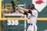 Vanderbilt Commodores outfielder Bryan Reynolds (20) points to his dugout after hitting a double during the NCAA College baseball World Series against the Cal State Fullerton Titans on June 15, 2015 at TD Ameritrade Park in Omaha, Nebraska. Vanderbilt beat Cal State Fullerton 4-3. (Andrew Woolley/Four Seam Images)