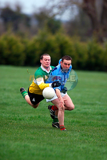 Tony Griffrety Newtown Blues with  Malcolm Carlan St Josephs on his Back, at the Match in Newtown...Pic Tony Campbell/Newsfile