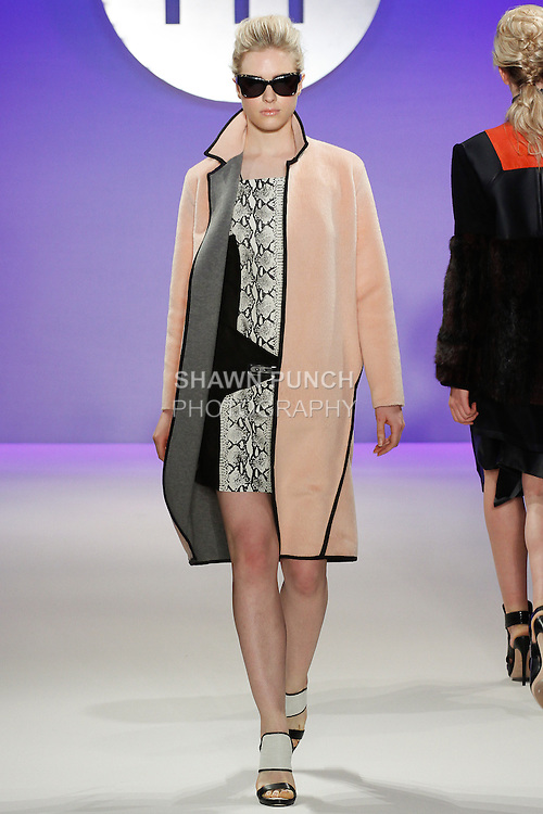 Model walks runway in an outfit by Olivia Franceschini, during the FIT Future of Fashion 2014 Graduates' Collection fashion show, at the Fashion Institute of Technology on May 1, 2014.