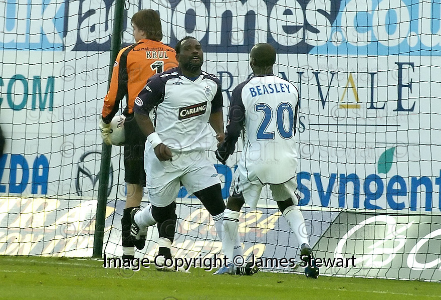 24/11/2007      Copyright Pic: James Stewart.File Name : sct_jspa12_falkirk_v_rangers.DAMARCUS BEASLEY CELEBRATES AFTER HE SCORES THE SECOND....James Stewart Photo Agency 19 Carronlea Drive, Falkirk. FK2 8DN      Vat Reg No. 607 6932 25.Office     : +44 (0)1324 570906     .Mobile   : +44 (0)7721 416997.Fax         : +44 (0)1324 570906.E-mail  :  jim@jspa.co.uk.If you require further information then contact Jim Stewart on any of the numbers above.........