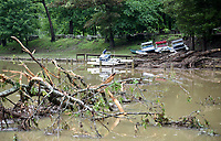 NWA Democrat-Gazette/DAVID GOTTSCHALK Floating debris, a damaged dock and displaced boats are visible Friday, June 7, 2019, following heavy rains that caused flash flooding on Lee Creek that runs through Devil's Den State Park. Flash flooding Thursday night closed two state highways in Washington County along with a number of county roads. No injuries had been reported by this morning.