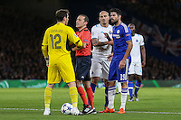 The referee separates Iker Casillas FC Porto (left) and Diego Costa of Chelsea after they clash during the UEFA Champions League group match between Chelsea and FC Porto at Stamford Bridge, London, England on 9 December 2015. Photo by David Horn / PRiME