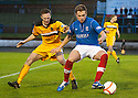 Cowdenbeath's Greg Stewart holds off Dumbarton's Martin McNiff  ...