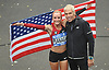 Shalane Flanagan, the first female runner to cross the finish line in the 2017 TCS New York City Marathon, holds an American flag as she poses with NYRR President and race director Peter Ciaccia after her win on Sunday, Nov. 5, 2017. She posted a time of 2:26.53 and became the first US- born woman in 40 years to claim a victory in the city's race.