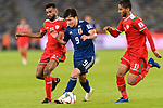 Minamino Takumi of Japan (C) is tackled by Harib Al Saadi (L) and Khalid Al Braiki of Oman (R) during the AFC Asian Cup UAE 2019 Group F match between Oman (OMA) and Japan (JPN) at Zayed Sports City Stadium on 13 January 2019 in Abu Dhabi, United Arab Emirates. Photo by Marcio Rodrigo Machado / Power Sport Images