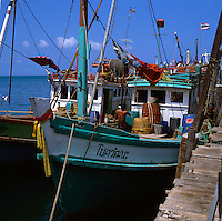 Fishing boats moored at jetty. Pattaya beach, Thailand,